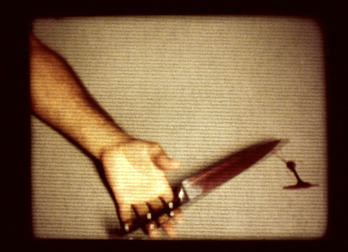 a bloody knife has fallen from a bloody hand on a distorted screen in a still from Clownhunter
